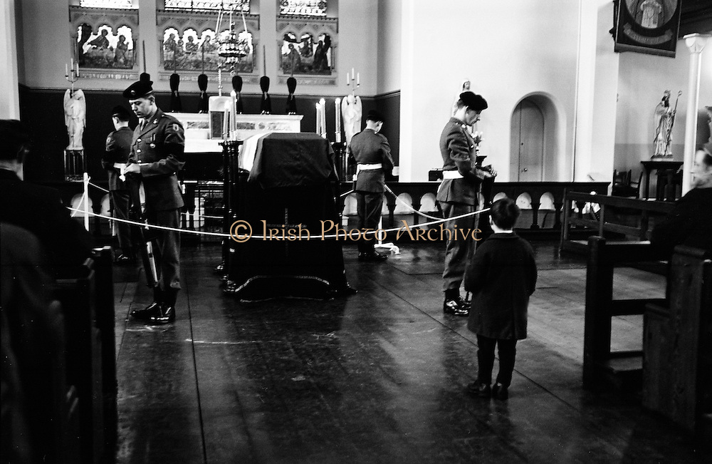 A young boy pays his respects as the body of Roger Casement lies in state at Arbour Hill. Casement had been hanged at Pentonville Prison in 1916. In 1965 his remains were repatriated to Ireland and he was given a state funeral, after which he was buried with full military honours in the Republican plot in Glasnevin Cemetery..24.02.1965