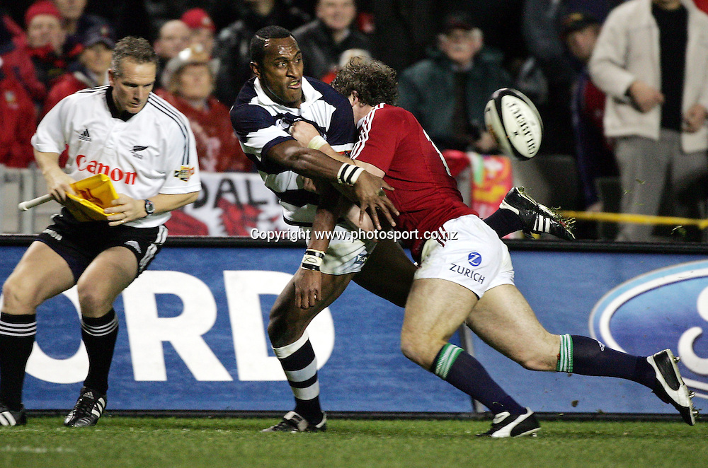 Auckland winger Joe Rokocoko gets his pass away during the Lions tour match vs Auckland at Eden Park, Auckland,Tuesday 5 July 2005. The Lions won the match 17-13. Photo:Andrew Cornaga/PHOTOSPORT<br /><br /><br />129509