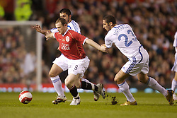 Manchester, England - Tuesday, March 13, 2007: Manchester United's Steven Gerrard is tackled by Europe XI's Marco Materazzi during the UEFA Celebration Match at Old Trafford. (Pic by David Rawcliffe/Propaganda)