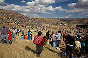 "The crowd swarms over a hill at Sacsayhuamán to view the ceremony moments after the police cordon was mobbed by local people. Inti Raymi ""Festival of the Sun"", Sacsayhuamán, Cusco, Peru."