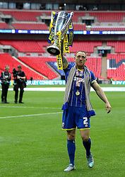 Barry Fuller of AFC Wimbledon celebrates winning promotion to League One with the League Two Playoff Final trophy - Mandatory by-line: Robbie Stephenson/JMP - 30/05/2016 - FOOTBALL - Wembley Stadium - London, England - AFC Wimbledon v Plymouth Argyle - Sky Bet League Two Play-off Final