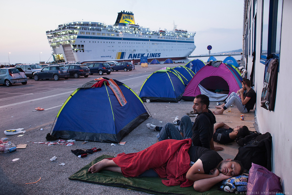 People sleeping before the sunrize.<br /> The port of Mytilene where many refugees stay while they apply for a permit to stay in Greece or while they are waiting to board the ferry to Athens.