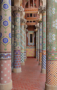 Columns covered with mosaic in floral designs, by Lluis Bru, on the balcony outside the Lluis Millet Room (a lounge area), on the first floor of the main facade of the Palau de la Musica Catalana, built 1905-8 and designed by the Catalan Modernist architect Lluis Domenech i Montaner, 1850-1923, in Casc Antic, Barcelona, Catalonia, Spain. The hall was built for the Orfeo Catala choral society in Catalan Modernist style, with art nouveau inspired organic forms and much attention to decorative detail. The concert hall was listed in 1997 as a UNESCO World Heritage Site. Picture by Manuel Cohen