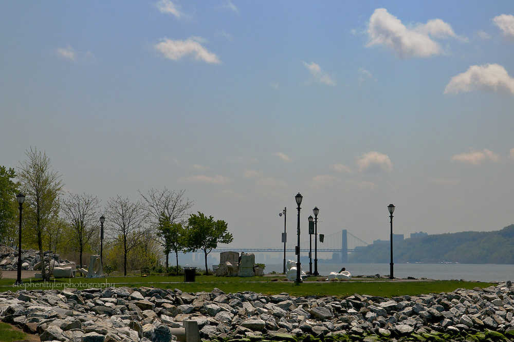 Sculpture Park on Promenade of Yonkers waterfront. George Washington Bridge and Manhattan skyline in the background; cliffs of New Jersey's Palisades on the right.