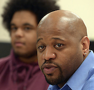 Minneapolis , MN -  April 27, 2015 - Michael Walker, head of the Minneapolis Public Schools new Office of Black Male Student Achievement, speaks to a group of African American male students  inside South High School on Monday, April 27, 2015. Juwan Child is the student sitting next to him. Photo by Johnny Crawford/ Johnny Crawford Photography