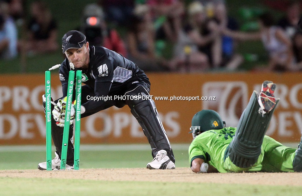 Brendon McCullum takes the bails off as he runs out Younis Khan during the 4th ODI, Black Caps v Pakistan, One Day International Cricket. McLean Park, Napier, New Zealand. Tuesday 1 February 2011. Photo: Andrew Cornaga/photosport.co.nz