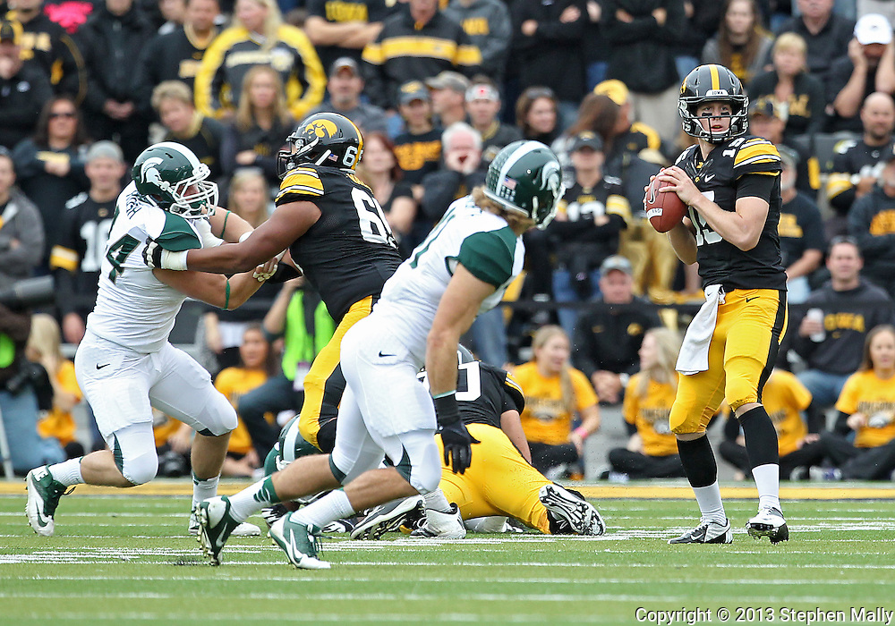 October 6 2013: Iowa Hawkeyes quarterback Jake Rudock (15) looks to throw during the first quarter of the NCAA football game between the Michigan State Spartans and the Iowa Hawkeyes at Kinnick Stadium in Iowa City, Iowa on October 6, 2013. Michigan State defeated Iowa 26-14.