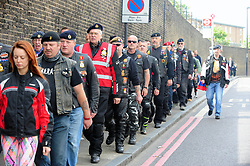 © Licensed to London News Pictures. 22/05/2017<br /> Flags are back up in Woolwich for Lee Rigby.<br /> Some bikers walk to the memorial to stand for the ride past.<br /> The Lee Rigby memorial motorbike ride took place this morning on the fourth anniversary of his death. Large numbers of bikers past the Lee Rigby memorial on Wellington Street near Woolwich Barracks, Woolwich,  which only days ago was attacked and damaged by vandals.<br /> Photo credit :Grant Falvey/LNP