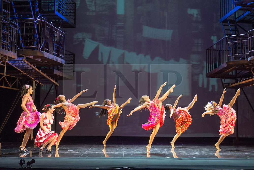 """© Licensed to London News Pictures. 07/08/2013. """"WEST SIDE STORY"""" returns to Sadler's Wells Theatre from Wednesday 7 August - Sunday 22 September 2013. This production is directed and choreographed by Joey McKneely using the full original Jerome Robbins choreography. Picture shows: Penelope Armstead-Williams (Anita) and the Shark Girls.  Photo credit: Tony Nandi/LNP"""