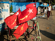 27 OCTOBER 2015 - YANGON, MYANMAR:  National League for Democracy (NLD) flags on a pedicab in Yangon. Political parties are in full campaign mode in Myanmar (Burma). National elections are scheduled for Sunday Nov. 8. The two principal parties are the National League for Democracy (NLD), the party of democracy icon and Nobel Peace Prize winner Aung San Suu Kyi, and the ruling Union Solidarity and Development Party (USDP), led by incumbent President Thein Sein. There are more than 30 parties campaigning for national and local offices.      PHOTO BY JACK KURTZ
