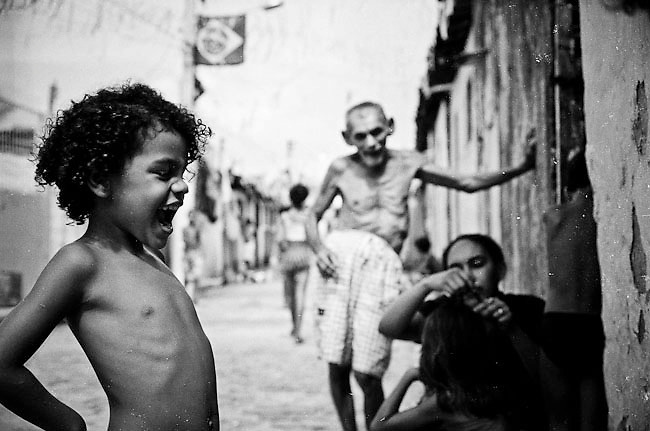 """Natal, Rio Grande do Norte, Brazil. Although the majority of Brazil's poor live in rural areas a jump in urban population growth has resulted in a concentration of poor families living in  shanty towns known as favelas. 80% of the population fo Brazil live today in urban areas. 45% of Brazil's children live in favelas where organized crime, drug use and child prostitution are part of the daily life. A greater part of the children that live in the favelas does not have acces to the education, thousands of children live on the street and they are exploited for sex tourism, or are victims of deadly squads that are pay it for """"cleaning"""" the streets of them."""