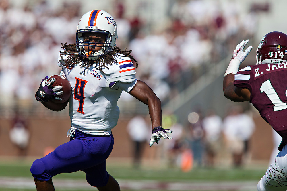 STARKVILLE, MS - SEPTEMBER 19:  Daniel Taylor #4 of the Northwestern State Demons runs the ball against the Mississippi State Bulldogs at Davis Wade Stadium on September 19, 2015 in Starkville, Mississippi.  The Bulldogs defeated the Demons 62-13.  (Photo by Wesley Hitt/Getty Images) *** Local Caption *** Daniel Taylor