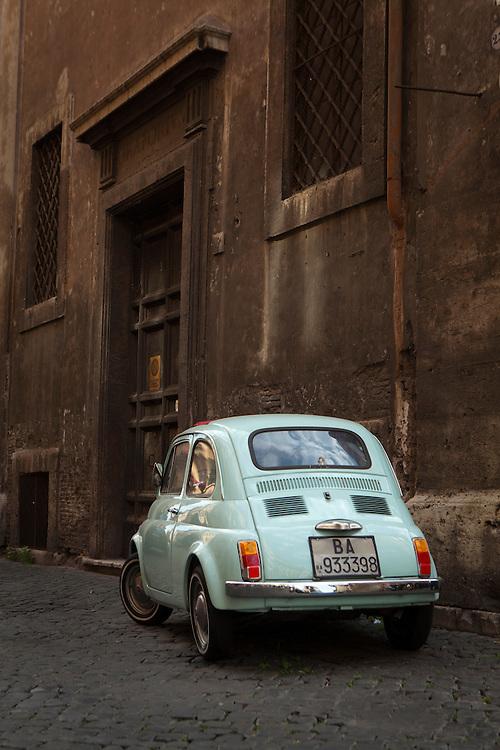 Classic Fiat 500 on Banchi Vecchi Street, Rome, Italy.