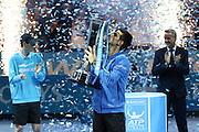 Novak Djokovic kisses the trophy during the final of the ATP World Tour Finals between Roger Federer of Switzerland and Novak Djokovic at the O2 Arena, London, United Kingdom on 22 November 2015. Photo by Phil Duncan.