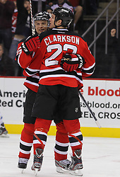 Jan 17; Newark, NJ, USA; New Jersey Devils right wing Petr Sykora (15) and New Jersey Devils right wing David Clarkson (23) celebrate Clarkson's goal during the second period at the Prudential Center.