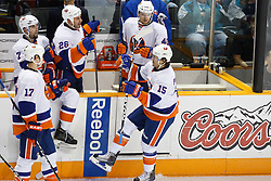 November 11, 2010; San Jose, CA, USA;  New York Islanders center P.A. Parenteau (15) celebrates with teammates after scoring a goal against the San Jose Sharks during the second period at HP Pavilion. Mandatory Credit: Jason O. Watson / US PRESSWIRE