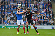 Portsmouth Defender, Matt Clarke (5) wins a header before Milton Keynes Dons Forward, Osman Sow (9) during the EFL Sky Bet League 1 match between Portsmouth and Milton Keynes Dons at Fratton Park, Portsmouth, England on 14 October 2017. Photo by Adam Rivers.