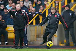 WOLVERHAMPTON, ENGLAND - Saturday, January 22, 2011: Liverpool's manager Kenny Dalglish gets a touch of the ball during the Premiership match against Wolverhampton Wanderers at Molineux. (Photo by David Rawcliffe/Propaganda)