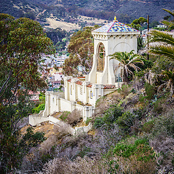 Catalina Chimes Tower on Catalina Island. The Chimes Bell Tower was built in 1925 by the Wrigley family and continue to ring throughout the day. The Catalina Chimes Tower is a Historic Landmark. Catalina Island is a popular travel destination off the coast of Southern California in the United States.