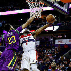Jan 29, 2017; New Orleans, LA, USA; Washington Wizards guard John Wall (2) dunks over New Orleans Pelicans forward Anthony Davis (23) during the first quarter of a game at the Smoothie King Center. Mandatory Credit: Derick E. Hingle-USA TODAY Sports