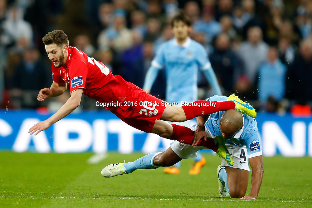 28 February 2016 - The Capital One Cup Final - Liverpool v Manchester City - Vincent Kompany of Manchester City fouls Adam Lallana of Liverpool - Photo: Marc Atkins / Offside.
