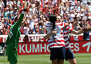 USA midfielder Amy Rodriguez, right, celebrates her game-winning goal with forward Sydney Leroux, (11) as Canada goalie Erin McLeod, left, reacts in the second half of their friendly match, Saturday, June 30, 2012, in Salt Lake City. USA defeated Canada 2-1. (AP Photo/Colin E Braley)
