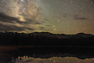 The milky way glows behind Loaf Mountain at Old Crow Lake in the Cloud Peak Wilderness.