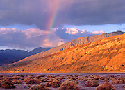 A rainbow forms over the Morman Point Turtleback in Death Valley National Park,CA<br /> Turtle backs are the geomorphic features of large fault planes. The slope of the turtleback  represents the fault pane surface.