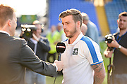 Plymouth midfielder Graham Carey is interviewed before kick off during the Sky Bet League 2 play-off first leg match between Portsmouth and Plymouth Argyle at Fratton Park, Portsmouth, England on 12 May 2016. Photo by Adam Rivers.