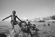 Southern Africa. Mozambique. Ilha de Mocambique..Abdul the water acrobat in front of the Portuguese fort..DVD0016