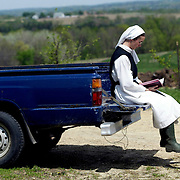 Sister Grace Remington studies a passage from the Bible in preparation for the Blessing of the Fields on St. Isidore's feast day at Our Lady of the Mississippi Abbey outside of Dubuque, Iowa.  The community of 22 Roman Catholic nuns follow Jesus Christ through a life of prayer, silence, simplicity and ordinary work.  Their home is a beautiful monastery which sits high on a bluff, overlooking the Mississippi River.