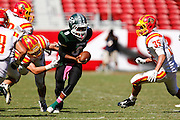 Manteca quarterback Dakarai Charles (8) tries to break Oakdale tackles during Friday Night Lights at Levi's Stadium in Santa Clara, California, on October 11, 2014. (Stan Olszewski/ Special to The Record)