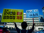SEOUL, SOUTH KOREA: A woman pickets the front of the US embassy in Seoul Tuesday afternoon.       PHOTO BY JACK KURTZ