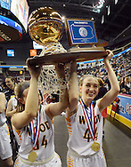 From left, Archbishop Wood's Meg Neher #34 and Claire Bassetti #44 carry the championship trophy off the court as they celebrate after defeating Villa Maria to win the girls basketball PIAA Class AAA state championship Saturday March 19, 2016 at the Giant Center in Hershey, Pennsylvania (Photo By William Thomas Cain)