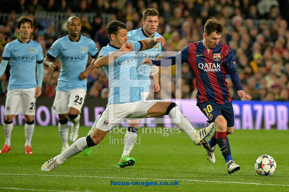Lionel Messi of FC Barcelona (right) shoots at goal during the UEFA Champions League match at Camp Nou, Barcelona<br /> Picture by Ian Wadkins/Focus Images Ltd +44 7877 568959<br /> 18/03/2015