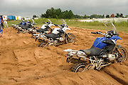 Six 2008 BMW R1200GS motorcycles are lined up and buried in a sand pit at the BMW Performance and test center in Spartanburg, SC during the BMW GS Trophy competition.  Contestants had to race against each other to free their bike from the deep sand and ride it out of the pit.