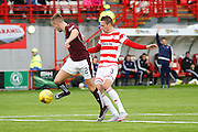 Hearts FC Midfielder Billy King attacks the goal through Hamilton Academical Defender Antons Kurakins during the Ladbrokes Scottish Premiership match between Hamilton Academical FC and Heart of Midlothian at New Douglas Park, Hamilton, Scotland on 24 January 2016. Photo by Craig McAllister.