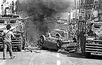 The Silver Jubilee visit of Queen Elizabeth II to N Ireland on 10th & 11th August 1977 sparked serious rioting in Belfast as those opposed to the visit tried to reach the city centre. Soldiers at the scene of a burning overturned car blocking a main route.  197708100074d<br />