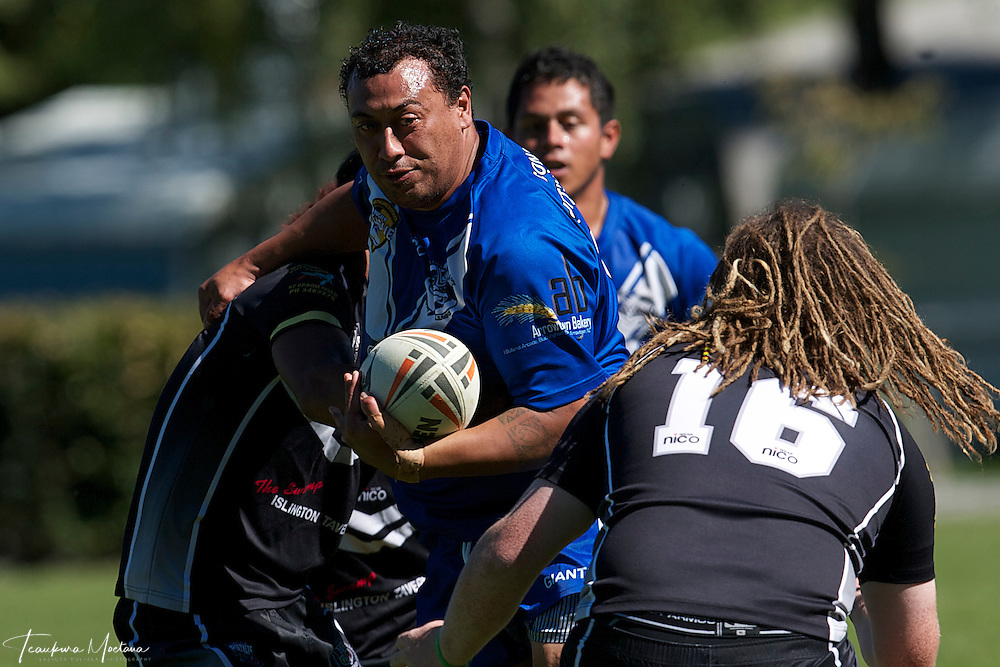 Brian Davis of the Wakatipu Giants is tackled by Dean Grace (L) and Lou Gimple (16) of Hornby Panthers U18s during the preseason Rugby league game between the Wakatipu Giants and Hornby U18s at the Jack Reid Park, Arrowtown, New Zealand. Saturday, March 17, 2012. Credit:Teaukura Moetaua / Media Sport