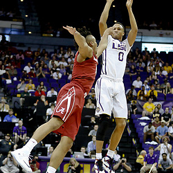 Jan 14, 2017; Baton Rouge, LA, USA; LSU Tigers guard Brandon Sampson (0) shoots over Alabama Crimson Tide guard Dazon Ingram (12) during the second half of a game at the Pete Maravich Assembly Center. Alabama defeated LSU 81-66. Mandatory Credit: Derick E. Hingle-USA TODAY Sports