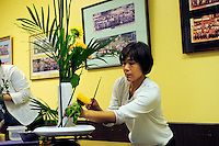 """Yumiko Aso from Aptos teaches """"ikebana"""" flower-arranging skills to attendees of a class at the Obon Festival at the Buddhist Temple of Salinas."""