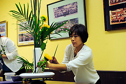"Yumiko Aso from Aptos teaches ""ikebana"" flower-arranging skills to attendees of a class at the Obon Festival at the Buddhist Temple of Salinas."