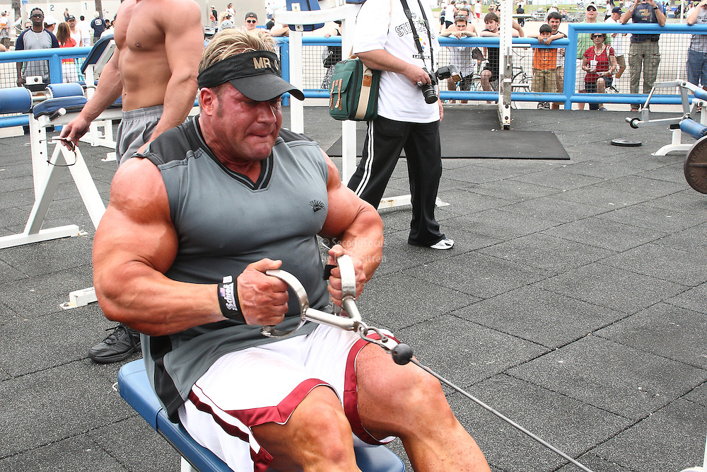 Mr. Olympia,  Jay Cutler doing seated back rows, working out in the pit at world famous Muscle Beach at Venice Beach California.