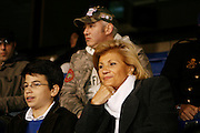 Saturday October 14th 2006. .Giants Stadium, East Rutherford, New Jersey. United States..Sacha Djorkaeff (left) and Marie Djorkaeff (right) watch their father and son Red Bulls French soccer player Youri Djorkaeff warming up before playing a game that could be his last one as a professional player against Kansas City at the Giants Stadium.
