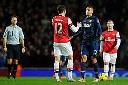 Man Utd Defender Chris Smalling (ENG) faces up to Arsenal Forward Olivier Giroud (FRA) after a late challenge - Photo mandatory by-line: Rogan Thomson/JMP - 07966 386802 - 12/02/14 - SPORT - FOOTBALL - Emirates Stadium, London - Arsenal v Manchester United - Barclays Premier League.