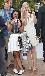 Actresses Jasmin Riggins (left) and  Siobhan Reilly take photographs of the media during a photo-call at the the Cannes Film Festival for the Ken Loach  film The Angel's Share. Tuesday, 22nd May 2012. Photo by: Stephen Lock / i-Images