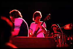 Keith Godchaux, Phil Lesh and Mickey Hart with the Grateful Dead in Concert at the Huntington Civic Center, Huntington West Virginia on 16 April 1978. Image No. 78C16-22