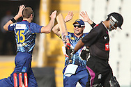 James McMillan of Otago Volts is congratulated by Nathan McCullum of Otago Volts after getting Ammar Mahmood Khan of the Faisalabad Wolves wicket during the Qualifier 1 match of the Karbonn Smart Champions League T20 (CLT20) between Otago Volts and the Faisalabad Wolves held at the Punjab Cricket Association Stadium, Mohali on the 17th September 2013<br /> <br /> Photo by Shaun Roy/CLT20/SPORTZPICS<br /> <br /> <br /> Use of this image is subject to the terms and conditions as outlined by the CLT20. These terms can be found by following this link:<br /> <br /> http://sportzpics.photoshelter.com/image/I0000NmDchxxGVv4<br /> <br /> ENTER YOUR EMAIL ADDRESS TO DOWNLOAD