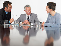 Three business colleagues in conference meeting