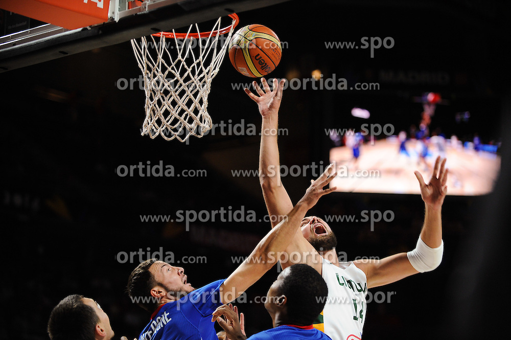 Joffrey Lauvergne of France vs Jonas Valanciunas of Lithuania in action during the 2014 FIBA World Basketball Championship Third Place match between France and Lithuania at the Palacio de los Deportes, on September 13, 2014 in Madrid, Spain. Photo by Tom Luksys  / Sportida.com <br /> ONLY FOR Slovenia, France